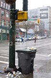 Garbage bin on a sidewalk Royalty Free Stock Image
