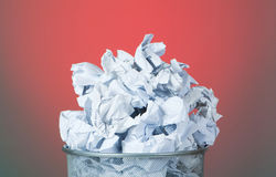 Garbage bin with paper against colourful bac Royalty Free Stock Photo
