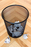 Garbage bin with paper waste Royalty Free Stock Photo