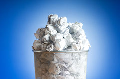 Garbage bin with paper waste isolated Stock Photo