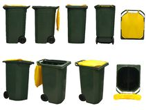 Garbage bins. Green garbage bins with yellow cover isolated on white background Royalty Free Stock Image
