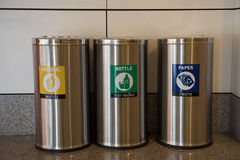Garbage bins. Recycling and garbage bins. bin, types of rubbish, separated by its color, Yellow general waste. Green for Bottle recyclable waste. Blue for Paper Stock Photography