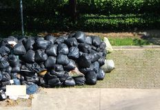 Garbage in a black bag waiting for service garbage truck. Royalty Free Stock Images