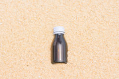 Garbage of bottle on the beach Royalty Free Stock Photos