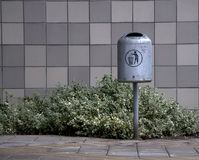 Garbage can. Outside a building Royalty Free Stock Images