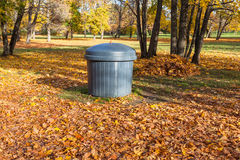 Garbage can in autumn park Royalty Free Stock Photos