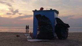 Garbage can on the beach stock video
