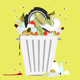 Garbage can full of trash. Large trash bin overflowing garbage (rotten fruit, old tires, packing of plastic, metal and glass). Trash fallen to the ground. Flies Stock Photo