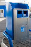 Garbage can on gas station. Blue garbage can on gas station royalty free stock photography