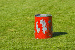 Garbage can on a green lawn Stock Image