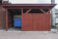 Garbage can. The wooden building with garbage containers Royalty Free Stock Images