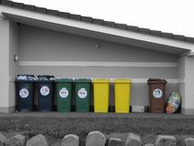 Garbage Cans. Shot of german garbage cans which have different colors for waste separation royalty free stock photos