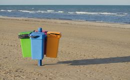 Garbage cans on the beach Royalty Free Stock Photos