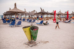 Garbage cans on a beach Stock Photo