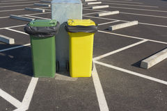 Garbage cans beside of the car parking. Stock Images
