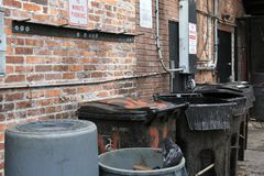 Garbage Cans in City Back Alley royalty free stock photo