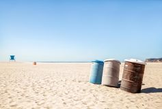Garbage cans on a deserted beach stock photo