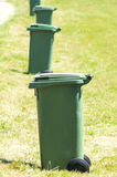 Garbage cans in the grass Stock Photography