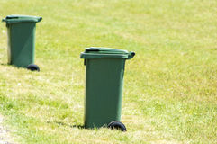 Garbage cans on the lawn Royalty Free Stock Images