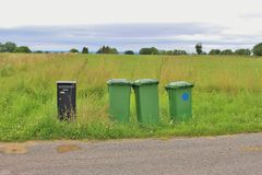 Garbage cans and a letterbox, Sweden, Lake Vanern. Royalty Free Stock Photos