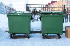 Garbage cans with trash on street Royalty Free Stock Photo