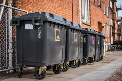 Garbage cans for waste sorting. Outside a house stock photo