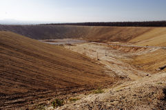 Garbage on the city landfill. Soil pollution. Environmental protection. Extraction of bio-gas. Quarry for extraction of gas from t Stock Images