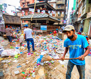 Garbage in the city. Sanitation worker handling garbage on the street of Kathmandu, Nepal