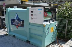 Garbage collection electric container waste in the village of Zermatt, Switzerland stock photo