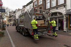 Garbage collection in Utrecht, Netherlands. Utrecht, Netherlands - January 24, 2018: Garbage collection in progress in the city streets of Utrecht Royalty Free Stock Photography