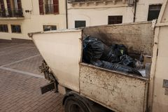 Garbage collection van. Urban scene Royalty Free Stock Photography