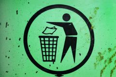 Garbage collection, waste management, sign on garbage container stock photos