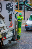 Garbage collector standing on truck, Paris, France Royalty Free Stock Image