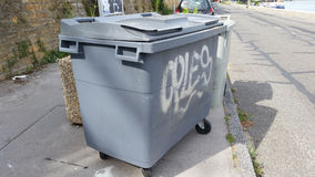 Garbage container. Gray four wheeled trash Royalty Free Stock Photo