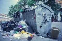 Garbage container overflowing in a city street royalty free stock photos