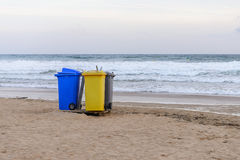 Garbage containers on the beach Stock Photography