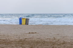 Garbage containers on the beach Royalty Free Stock Images
