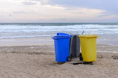 Garbage containers on the beach Royalty Free Stock Photo