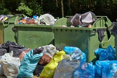 Garbage Containers Full, Overflowing Royalty Free Stock Image