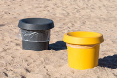 Garbage containers on the sea beach Stock Photo
