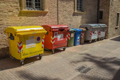 Garbage containers. Various containers for garbage in a street in Urbino, Italy Royalty Free Stock Image