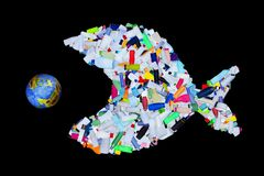 Garbage destroying world oceans and earth - concept. Garbage destroying our world oceans and earth - concept with plastic bottles fish eating the planet royalty free stock images