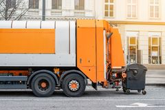 Garbage disposal lorry at city street. Waste dump truck on town road. Municipal and urban services. Waste management, disposal and. Recycling. Mock-up empty royalty free stock images