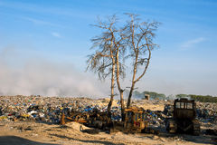 Garbage dump. Scrap metal, plastic and blue sky Royalty Free Stock Image