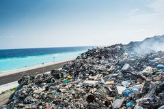 Garbage dump area view full of litter, plastic bottles,rubbish and other trash at the Thilafushi tropical island. Garbage dump area view  full of litter, plastic Royalty Free Stock Photos