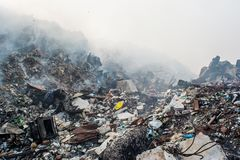 Garbage dump area view full of smoke, litter, plastic bottles,rubbish and other trash at the Thilafushi local island. Garbage dump area view full of smoke,litter stock photo