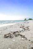 Garbage dump on a beach Royalty Free Stock Photo