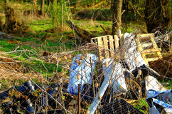 The garbage dump behind the fence Stock Images