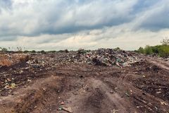 Garbage dump and cloudy sky. Illegal garbage dump and cloudy sky Stock Photo