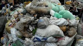 Garbage dump are collected in the city market site, a measure to sanitize the facility. San Pablo City, Laguna, Philippines - June 23, 2015: Garbage dump are stock video footage